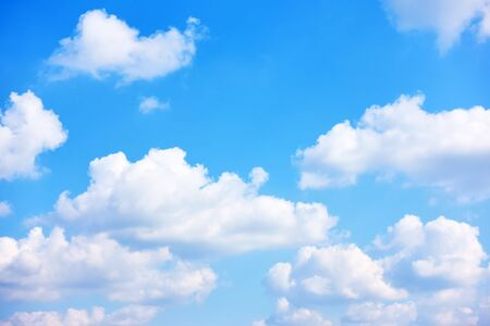Blue sky with white cumulus clouds -  natural background with space for your own text
