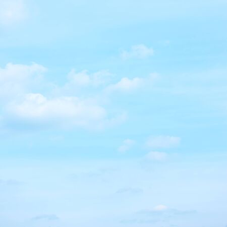 Light pastel blue sky small clouds -  background with space for your own text 스톡 콘텐츠