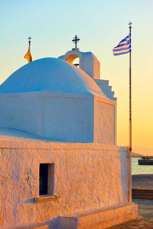 Agios Nikolaos greek orthodox church in the port of Aegina island at sunset, Greece 写真素材