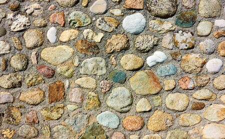 Texture of masonry of rounded stones, may be used as background 写真素材