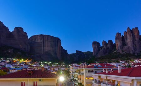 Panoramic view of Meteora rocks and Kalabaka town at twilight,  Greece. Greek landscape - cityscape 写真素材