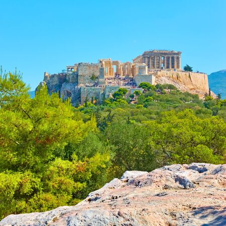 The Acropolis in Athens fron the Hill of the Nymphs on summer sunny day, Greece - Greek landscape 写真素材