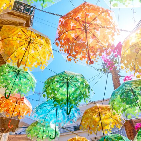 Street decorated with colorful umbrellas on summer sunny day,