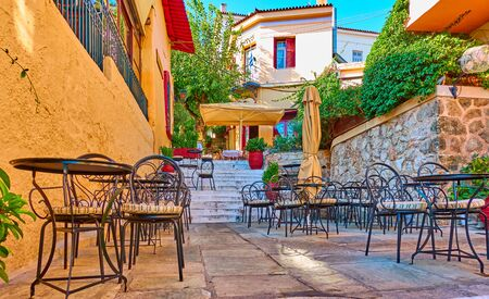 Charming street cafe in Plaka district in Athens, Greece 写真素材