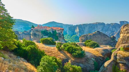 Panorama of Meteora with The Holy Monastery of Varlaam in the morning, Greece -  Greek panoramic landscape
