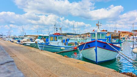 Panoramic view of port of Aegina and old fishing boats, Saronic Islands, Greece. Copyspace composition