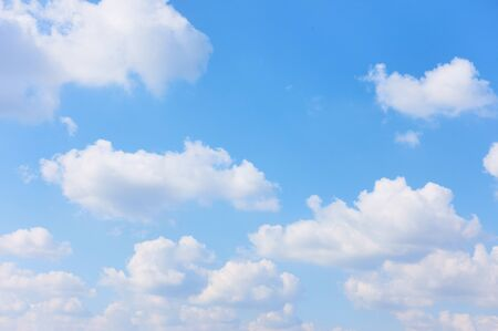 Blue sky with white cumulus clouds , may be used as background