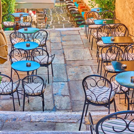 Street cafe - Tables outdoor on the stairs in Plaka district in Athens, Greece 写真素材