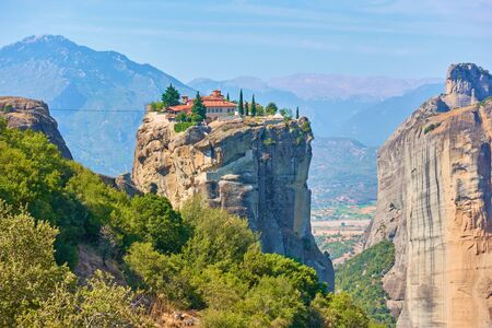 The Holy Trinity monastery on the top of cliff in Meteora, Thessaly, Greece  - Greek landscape 写真素材