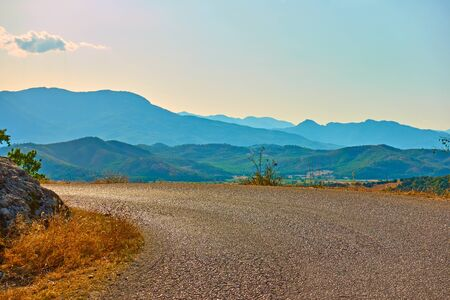 Road bend and panoramic view of Thessaly valley in the evening, Greece -  Picturesque greek scenery 写真素材