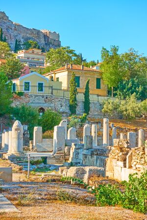 Ruins of Roman Forum  and Plaka district on the slope of Acropolis hill in Athens in the morning, Greece 写真素材