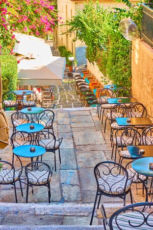 Street cafe on the stairs in Plaka district in Athens, Greece