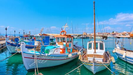 Panoramic view of port of Aegina with old fishing boats, Saronic Islands, Greece