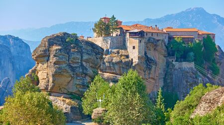 Panoramic view of The Holy Monastery of Varlaam on the top of the cliff in Meteora in the morning, Greece -  Greek landscape