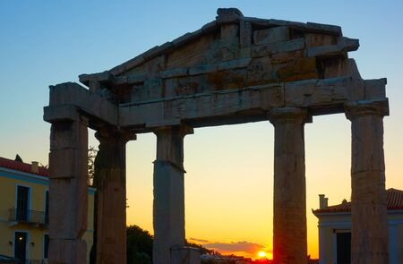Silhouette of the Gate of Athena Archegetis at Roman Forum in Athens at sunset, Greece. Greek sundown