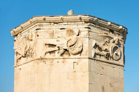 Tower of The Winds in Athens with ancient bas-reliefs on the top, Greece