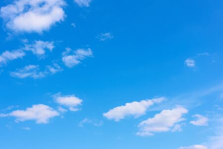 Blue sky with light white clouds -  background with space for your own text