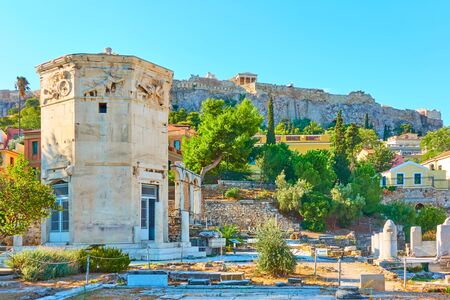 Ruins of The Roman Forum  and Plaka district on the slope of Acropolis hill in Athens in the morning, Greece