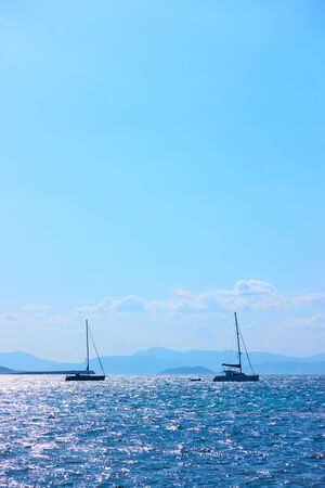 Yachts in the sea on the summer day and blue sky, Greece. Copyspace composition