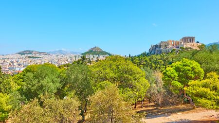Panorama of Athens city with the Acropolis, Mount Lycabettus  and public park on the Hill of the Nymphs on summer sunny day, Greece - Greek landscape