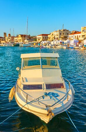 Fishing boat in the port of Aegina in the sunny evening, Saronic Islands, Greece