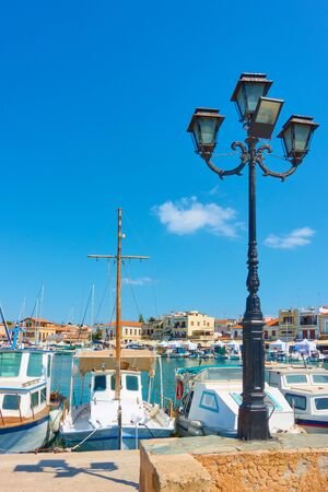 Port and seafront in Aegina town on sunny summer day, Saronic Islands, Greece
