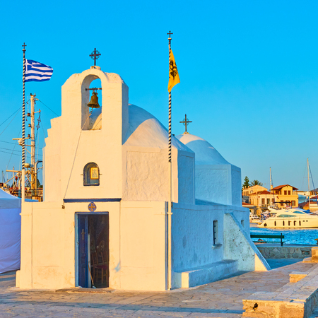 Greek orthodox church of Agios Nikolaos in the port of Aegina town at sunset, Greece