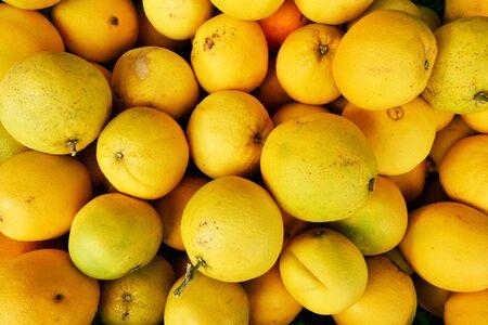 Organic orange fruits at the market, may be used as background Stock Photo