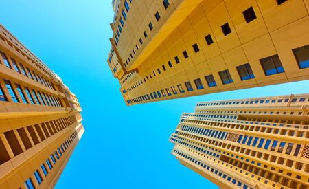 Angle shot of modern dwelling houses against the clear blue sky