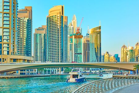 Modern towers of Dubai Marina and waterfront in the evening, United Arab Emirates