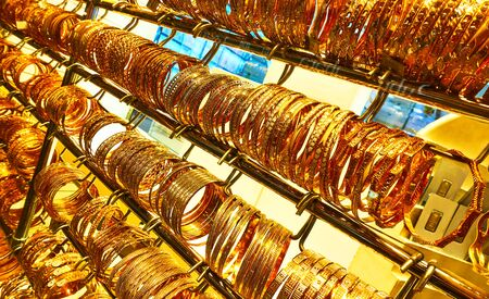 Golden bracelets in a jewelery shop at the Golden Souk market in Dubai, UAE 스톡 콘텐츠
