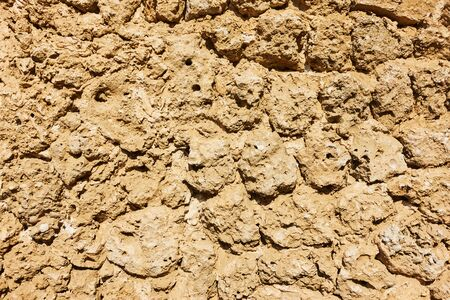 Texture of remains of ancient surrounding wall in Dubai, UAE Stock Photo