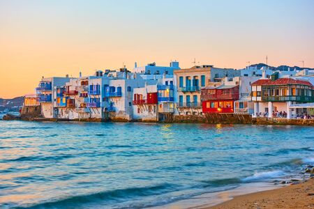 The Little Venice district with old colorful houses by the sea in Mykonos Island at sunset, Cyclades, Greece. Greek landscape
