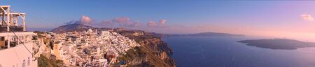 Panorama of Santorini island with Thira town on the cliff in the evening, Greece -- Greek panoramic landscape - cityscape 版權商用圖片