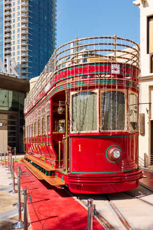 Dubai, UAE - February 02, 2020: Red retro tram in the Downtown Dubai, United Arab Emirates Editorial