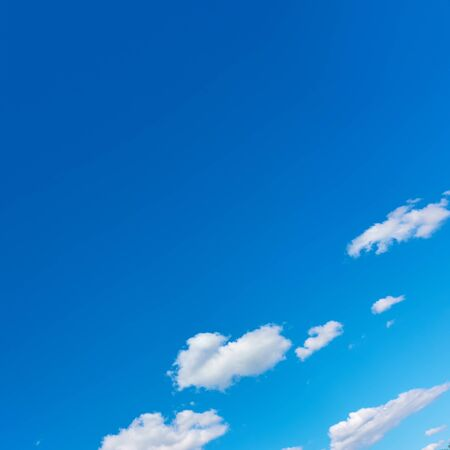 Blue sky with white clouds - square background with space for your own text