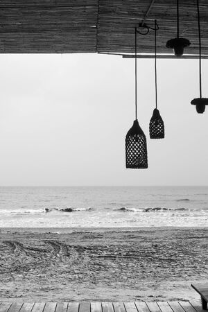 Deserted beach bar by the sea - Black and white photography