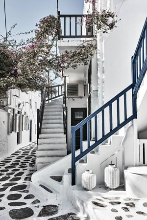 Old street with whitewashed houses in Mykonos, Greece - Greek cityscape