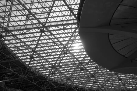 Skylight window - huge industrial construct with glass ceiling. Black and white architectural photography
