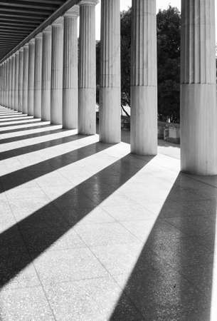 Perspective of classical greek columns, Athens, Greece. Black and white architectural photography