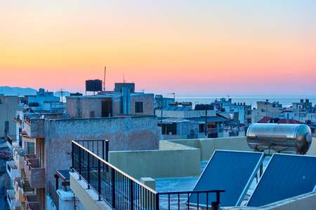 Rooftops of Heraklion and sunset sky, Crete, Greece Imagens