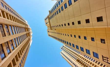 Multistory dwelling buildings against the blue sky, Dubai, UAE