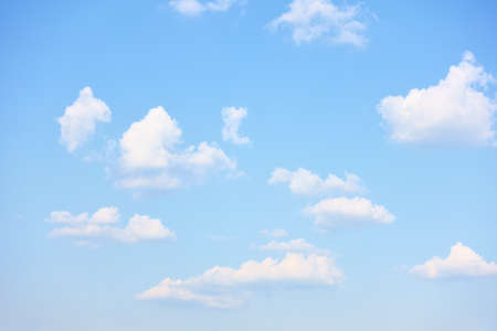 Light blue sky with rare white clouds, may be used as background