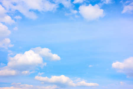 Blue sky with white cumulus clouds , may be used as background. Cloudscape with copy space
