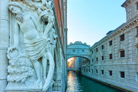 Drunkenness of Noah sculpture and The Bridge of Sighs in Venice, Italy