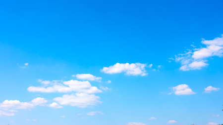 Blue spring sky with white clouds