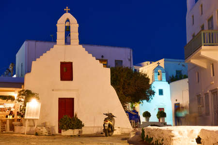 Greece, Mykonos island. Square with ancient church in Chora town at night. Greek architecture, cityscape