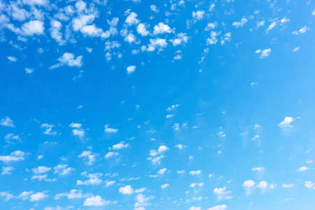 Blue sky with tiny little white clouds. Background with space for your own text Standard-Bild