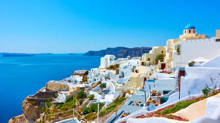Santorini Island in Greece. Panoramic view of Oia town on the coast by the sea. Greek landscape
