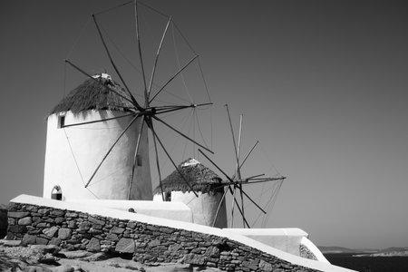 Fabulous windmills by the sea in Mykonos island in Greece. Greek landscape, black and white photography